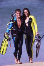 Couple scuba diving on the beach